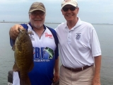 Dave Reault with a nice smallmouth bass with Michigan State Representative Tim Kelly