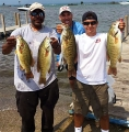 Jay Vanreed and Matthew Davis with some of their bass