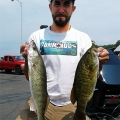 Zack Morrison with a walleye and smallmouth bass