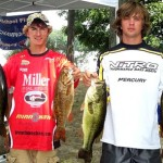 Captain Jack Horning stands with 2011 Michigan High School Fishing state champions Danny Sprague and Clayton Sprague