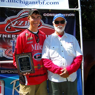 2012 older group winner Danny Sprague gets his picture taken with his volunteer boater for the day on Pontiac Lake, Chuck Reese