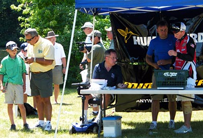 Star host of Hook n' Look Kim Stricker (yellow shirt) made an excellent emcee for the 2012 TBF of Michigan Jr State Championship while Youth Director Brian Belevender (standing, blue shirt) and past champion Cody Harris read off the kids' total catch weight