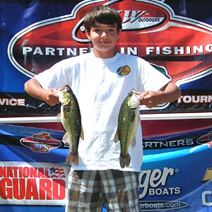 2012 TBF of Michigan 11 to 14 years old Jr state champion Matt Davis shows 2 Pontiac Lake bass from his winning limit of bass that weighed 9.82 pounds