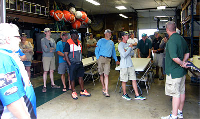 MDNR bass tournament liaison Tom Goniea presents information about the Michigan Fishing Tournament Information System to the MLSC bass fishing outing participants.
