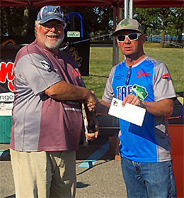 The Bass Federation of Michigan President Dave Reault present payout winnings to 2017 National Semi-Final boater champion Pat Upthagrove - a TBF of Michigan member.