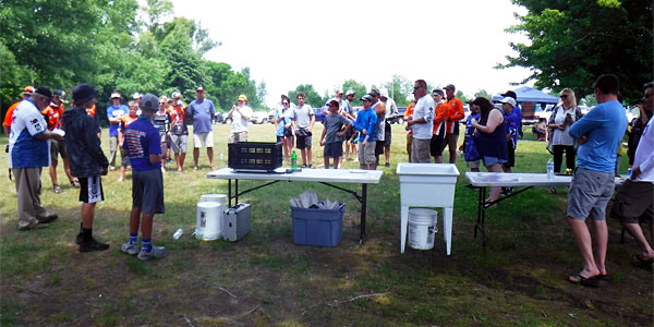 Partiicipants, volunteers and parents prepare for weigh-in at the 2018 TBF of Michigan Junior State Championship June 17 at Pontiac Lake
